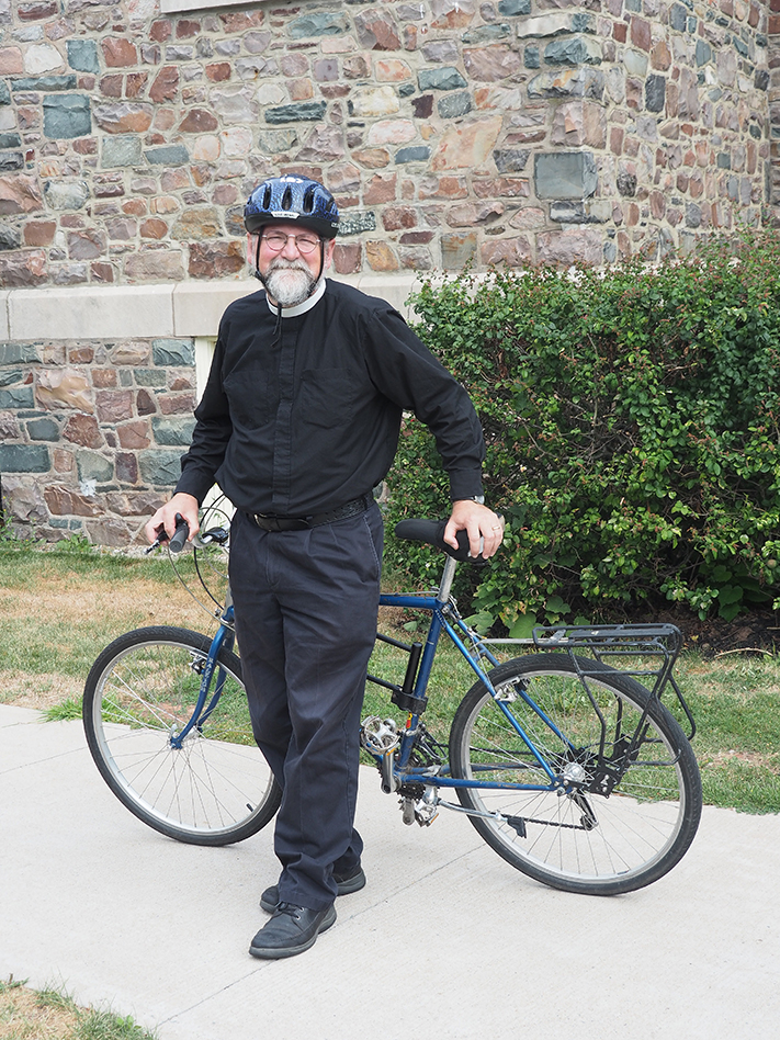 Ranall Ingalls next to his bicycle