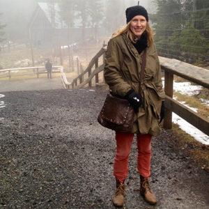 Miriam Toews stands on a bridge