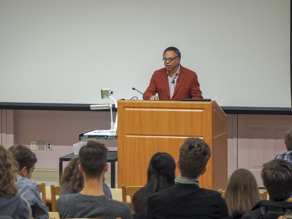 George Elliott Clarke speaks at a podium.