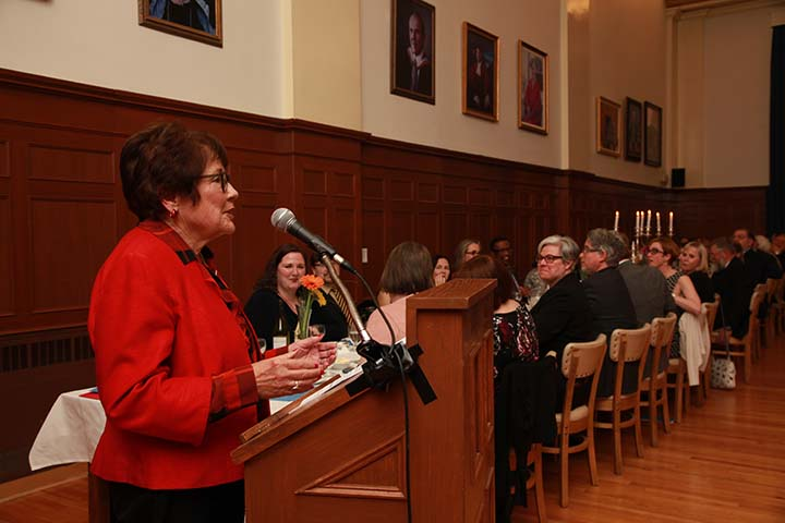 Dale Godsoe speaks at a podium at the President's Dinner.