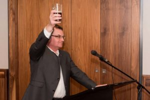 President Lahey raising a glass in a toast.