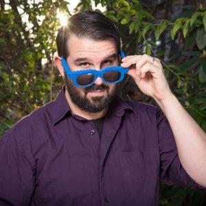 Trevor Murphy, wearing blue sunglasses.